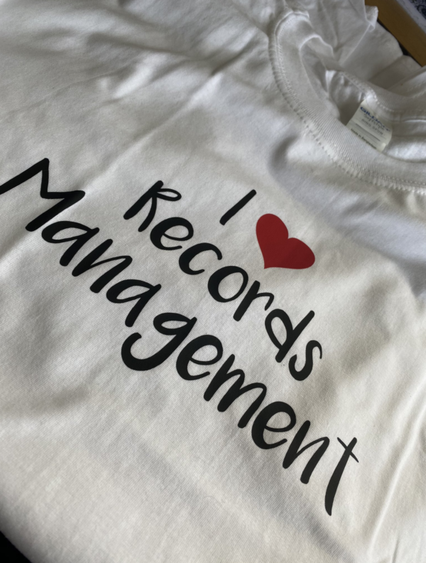 Picture of white tshirt with I Heart Records Management on it.