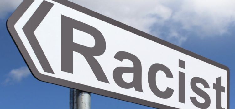 Road sign that says Racist