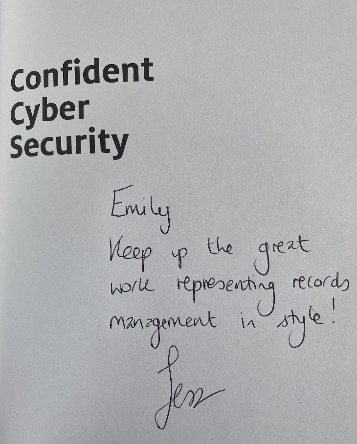 """Screenshot of the first book page with Confident Cyber Security with a handwritten note that says """"Emily, Keep Up the great work representing records management in style! Jess"""""""